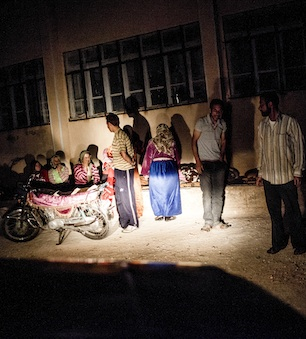 Displaced Syrian families set up to sleep.